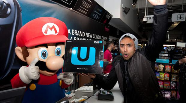 Izzy Rahman, 25, from London is the first to buy the Nintendo Wii U from the HMV store on London's Oxford Street, after queuing for six days for the launch. PRESS ASSOCIATION Photo. Picture date: Thursday November 29, 2012. Photo credit should read: David Parry/PA Wire