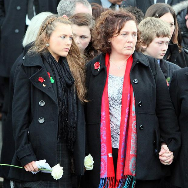 Yvonne Black, wife of murdered prison officer David Black, with her daughter Kyra after his funeral service in Co Tyrone