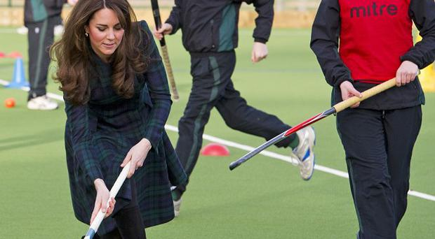 The Duchess of Cambridge shows off her hockey skills (Arthur Edwards/The Sun/PA Wire)