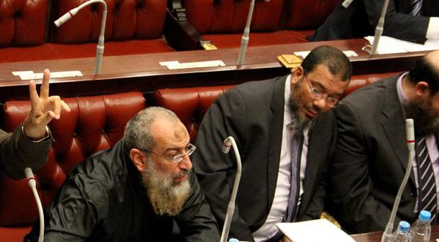 Members of the constitutional assembly attend a session to vote on a final draft of a new Egyptian constitution (AP)