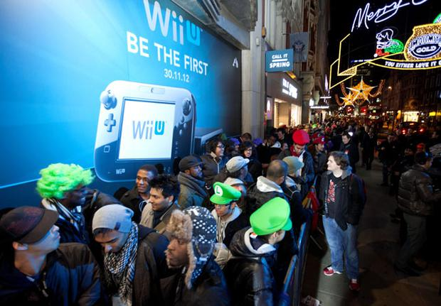 Nintendo fans brave the winter weather and queue outside HMV Oxford Street in central London for the launch of Wii U, the latest home console from Nintendo