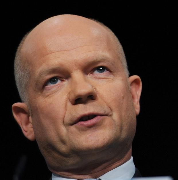 Foreign Secretary William Hague has urged Israel to scrap plans to build new housing settlements in the West Bank