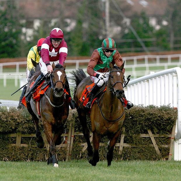 Midnight Game, left, goes on to win The United Arab Emirates Embassy Maiden Hurdle