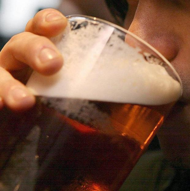 Pub owners called for a 15 per cent tax on drinks sold at off-licences, claiming it would help safeguard 50,000 jobs in the pub trade