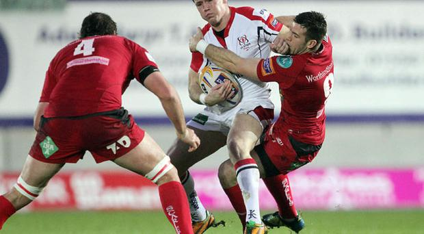 Ulster's Craig Gilroy is tackled by Scarlet's Gareth Davies.