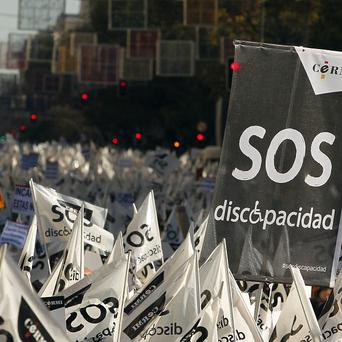 People march in Madrid against the Spanish government's austerity measures affects on disabled people (AP)