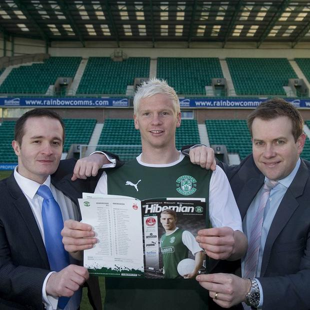 Rainbow Communications' Tom McDonald and Stuart Carson stand with Northern Ireland international and Hibs player Ryan McGivern
