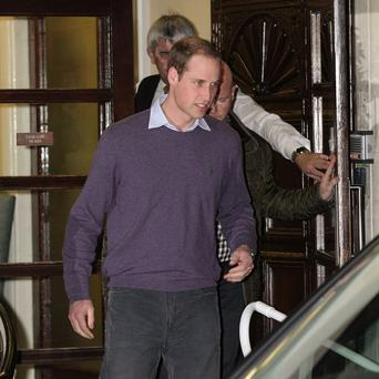 The Duke of Cambridge leaving King Edward VII Hospital in central London after visiting his wife