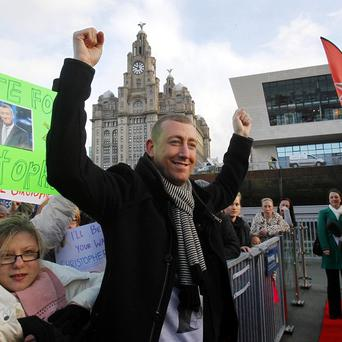 X-Factor finalist Christopher Maloney arrives back in Liverpool