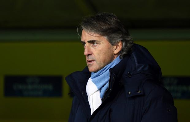 DORTMUND, GERMANY - DECEMBER 04: Roberto Mancini, head coach of Manchester looks on before the UEFA Champions League group D match between Borussia Dortmund and Manchester City at Signal Iduna Park on December 4, 2012 in Dortmund, Germany. (Photo by Martin Rose/Bongarts/Getty Images)