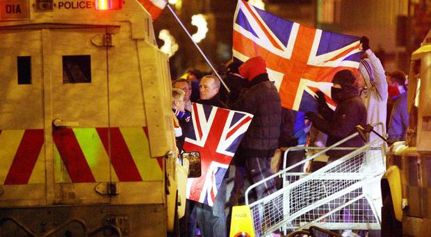 Riot: protesters at Belfast City Hall did nothing to enhance the image of loyalists