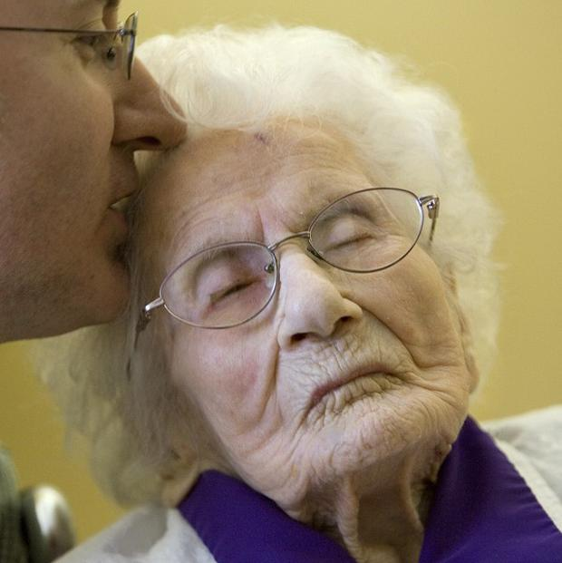 Besse Cooper is kissed by her grandson Paul Cooper, 42 (AP/John Amis)