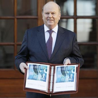 Finance Minister Michael Noonan delivers the 2013 Budget at Government Buildings, Dublin
