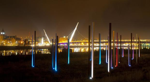 Ireland's largest public artwork Mute Meadowat Ebrington in the Waterside in Derry which was beset by electrical problems and is now fully operational. The steel columns have lights below them which pulse and change colour based on sounds which have been recorded around Londonderry. Picture Martin mckeown. Inpresspics.com. 05.12.12