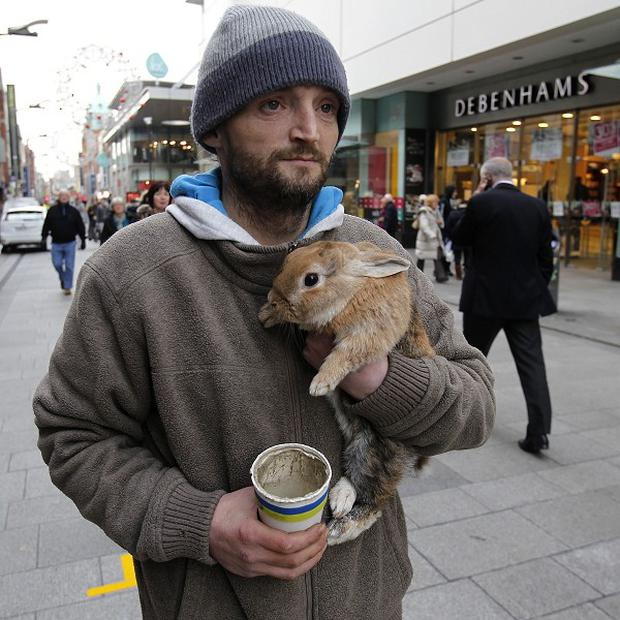 John Byrne on the streets of Dublin with his pet rabbit Barney before it was thrown into a river
