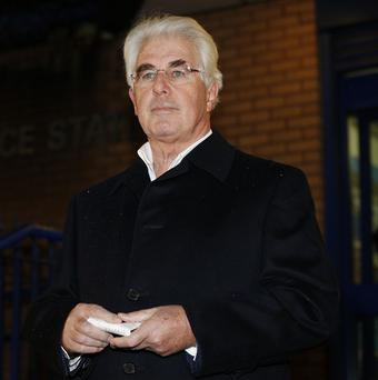 PR guru Max Clifford speaks to the media outside Belgravia police station, in central London