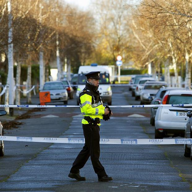 Gardai at the scene on Furry Park Road, Dublin, where Eamon Kelly was shot dead