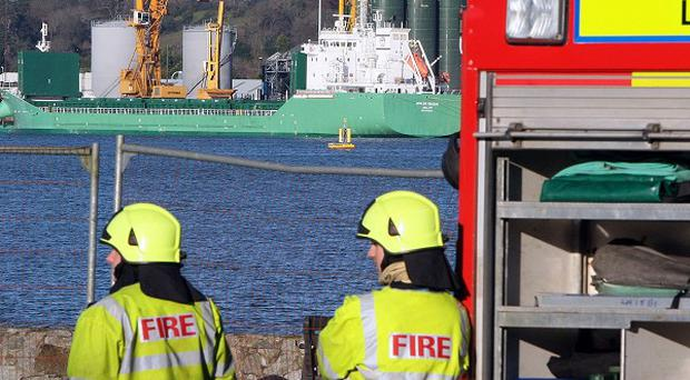 Firemen from Omeath in Co Louth monitor the MV Arklow Meadow at Warrenpoint harbour