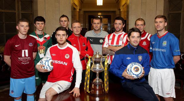 Players from the competing clubs get a look at the silverware at the Setanta Sports Cup draw at Stormont