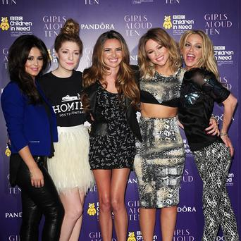 Cheryl Cole is apparently concentrating on Girls Aloud instead of her solo music for now