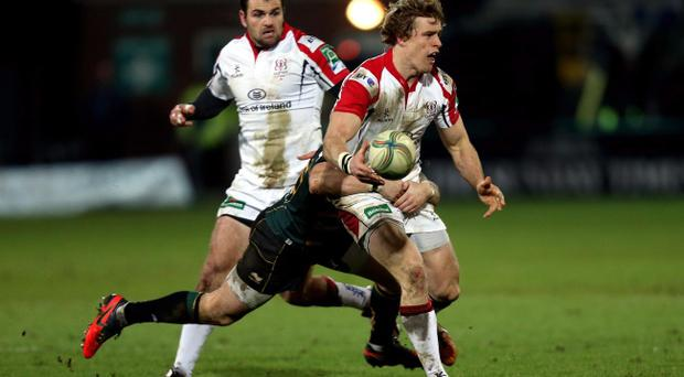 Ulster's Andrew Trimble is tackled by Northampton's Ryan Lamb during the Heineken Cup Pool Four match at Franklins Gardens