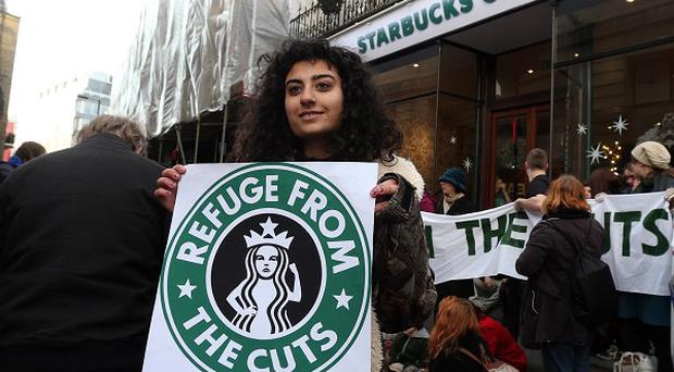Protesters outside Starbucks in Vigo Street, central London