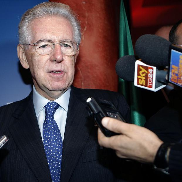 Italian Prime Minister Mario Monti said he intends to resign (AP)