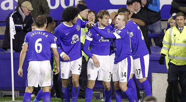 Everton's Nikica Jelavic (centre) celebrates scoring his side's second goal of the game with teammates during the Barclays Premier League match at Goodison Park