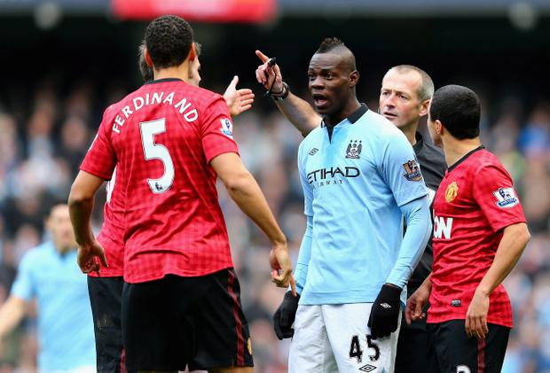 MANCHESTER, ENGLAND - DECEMBER 09: Rio Ferdinand of Manchester United and Mario Balotelli of Manchester City have words during the Barclays Premier League match between Manchester City and Manchester United at the Etihad Stadium on December 9, 2012 in Manchester, England. (Photo by Clive Mason/Getty Images)