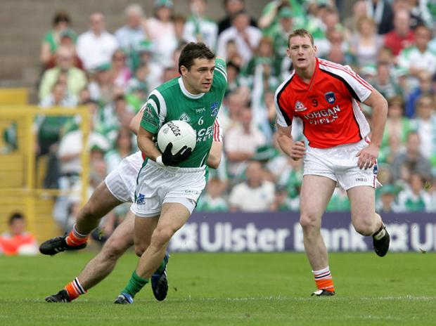 Fermanagh's Ryan McCluskey (left)