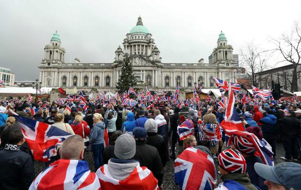 Protesters gather at Belfast City Hall on Saturday