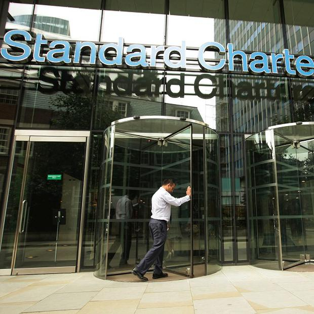Standard Chartered will pay another 327 million dollars over allegations it breached sanctions with Iran