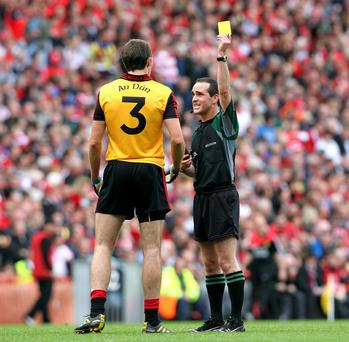 GAA All Ireland Senior Football Championship Final 19/9/2010DownReferee David Coldrick issues a yellow card to Dan Gordon Mandatory Credit ©INPHO/Lorraine O'Sullivan *** Local Caption ***