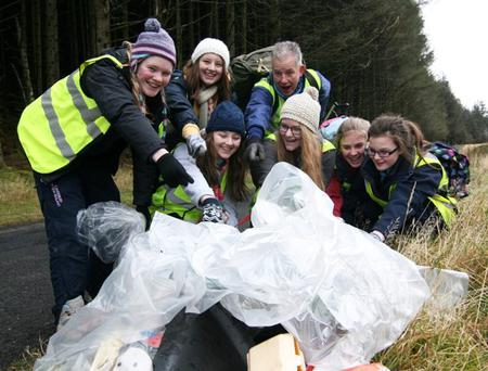 Mary Cousins, Lori McDermott and Billy Thompson (back row), and Cherie McDermott, Gemma McCullough, Ciara Patterson and Carly Wilkinson with some of the rubbish they found