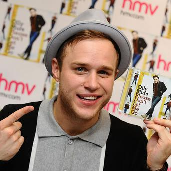 Olly Murs has been knocked off the top spot
