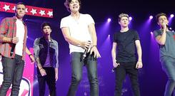One Direction have got used to cameras following them around