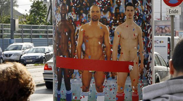 A poster in Vienna advertises an exhibition of pictures and sculptures portraying nude men through the ages (AP)