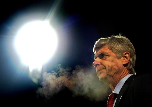 BRADFORD, ENGLAND - DECEMBER 11: Arsene Wenger the Arsenal manager looks on during the Capital One Cup quarter final match between Bradford City and Arsenal at the Coral Windows Stadium, Valley Parade on December 11, 2012 in Bradford, England. (Photo by Laurence Griffiths/Getty Images)