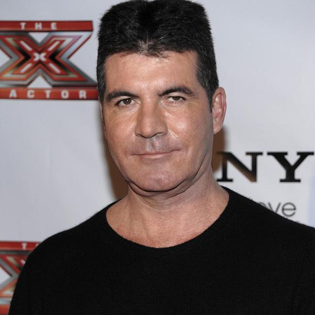Simon Cowell was spotted on a dinner date with True Blood actress Janina Gavankar