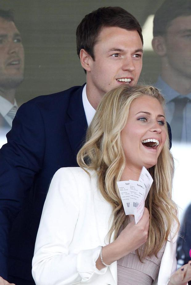 Jonny Evans and fiancée Helen enjoying a day at the races at Aintree earlier this year