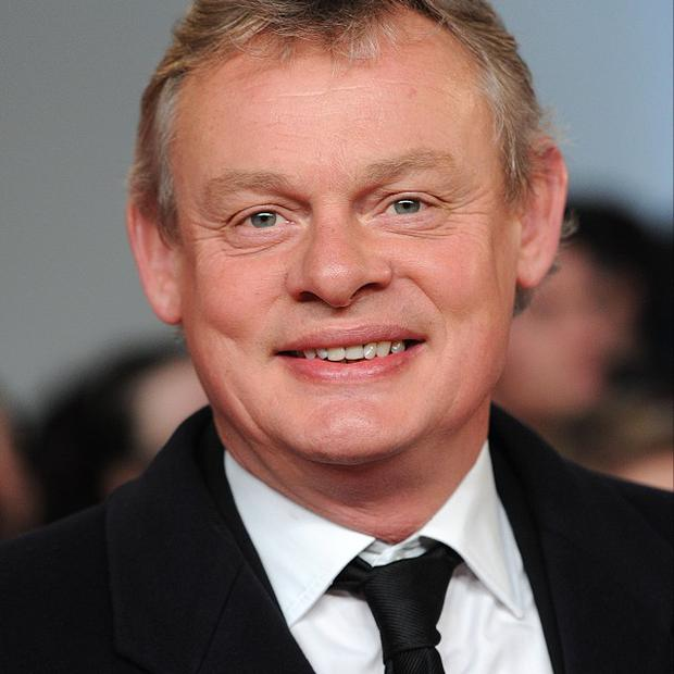 Martin Clunes says he is too 'tall and odd-looking' to be a typical leading man