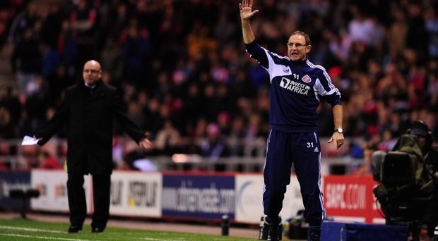 SUNDERLAND, ENGLAND - DECEMBER 11: Sunderland manager Martin O' Neill (r) reacts as Reading manager Brian McDermott (l) looks on during the Premier League match between Sunderland and Reading at Stadium of Light on December 11, 2012 in Sunderland, England. (Photo by Stu Forster/Getty Images)