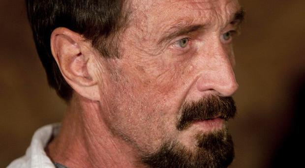 John McAfee was detained in Guatemala for immigration violations (AP)