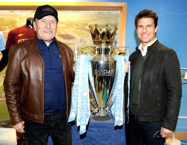 Robert Duvall and Tom Cruise pose with the World Series of Soccerball Cup at the Etihadbowl