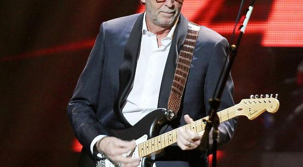 Eric Clapton performing at The Concert for Sandy Relief at Madison Square Garden in New York (Starpix/AP)