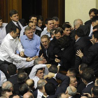 Ukrainian politicians fight during the first session of the country's newly elected parliament (AP)