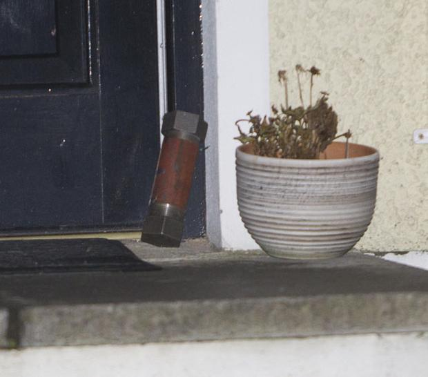 A pipe bomb sits beside Mark Pearce's front door
