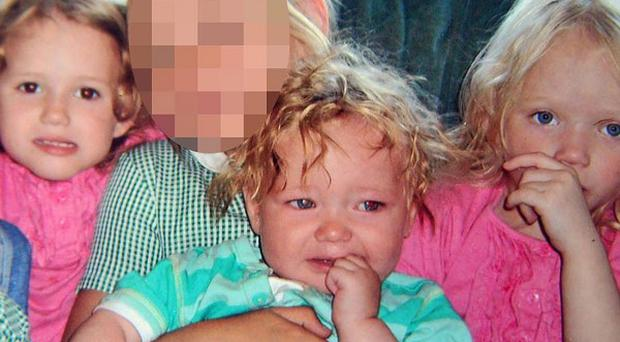 Jordan Smith, 2, (front) and twins Holly and Ella Smith, 4, (in pink) who died in a house fire in Freckleton, Lancashire