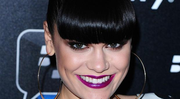 Jessie J has postponed her tour in order to spend more time in the studio making her next album