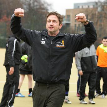 Gerard Butler plays a soccer coach in Playing For Keeps